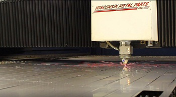 5000-watt fiber laser cutter in action in the metal fabrication department