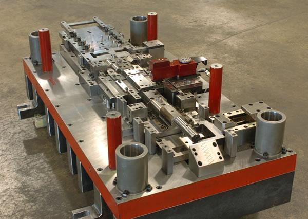 Progressive In Die Tapping Wisconsin Metal Parts Inc